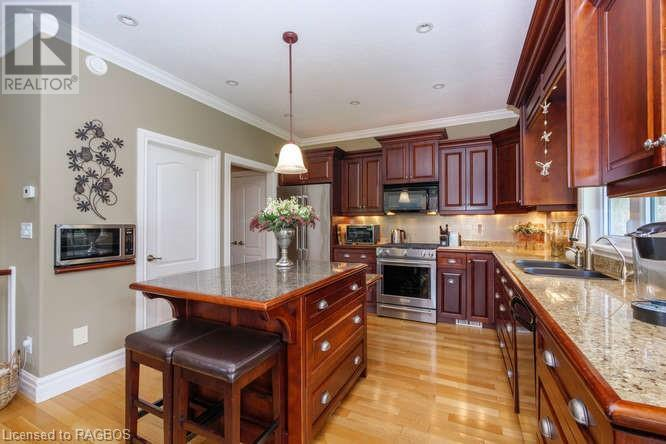 Beautiful cherry cabinets, a propane stove and centre island make this kitchen great for entertaining.